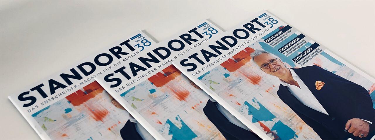 Foto von drei Zeitschriftencovern des Magazins Standort38